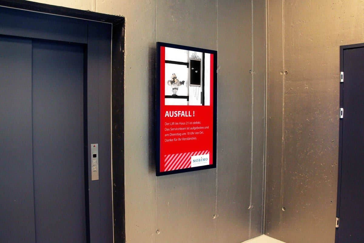 Digital signage by elevator with animation of Maintenance Man advising of service interruption