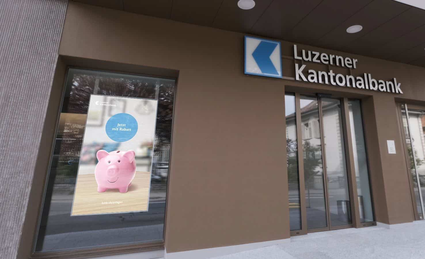 Luzerner Kantonalbank outside with point of sale display of piggy bank animation